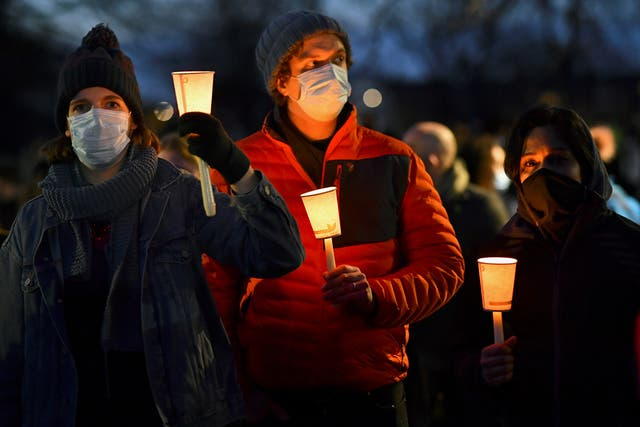 People gather at a memorial site