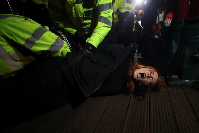 Police detain a woman