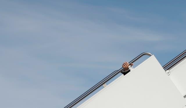 U.S. President Joe Biden stumbles on steps departs on travel to Atlanta, Georgia at Joint Base Andrews in Maryland