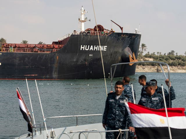 A ship heads down the Suez Canal, in Ismalia, Egypt