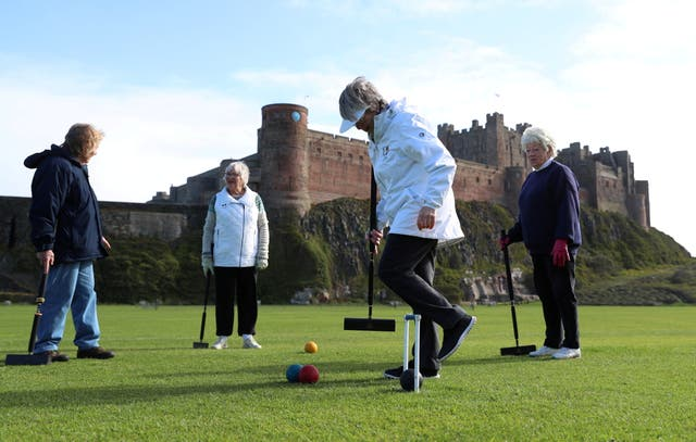 Members of the Bamburgh Croquet club play a game following the easing of COVID-19 restrictions in Northumberland, Britain