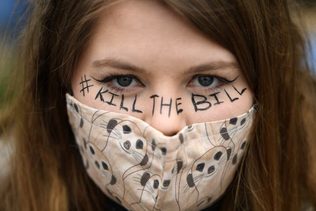 A woman looks into the camera as she attends a 'Kill the Bill' protest in London