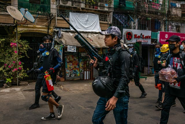 Anti-coup protesters hold improvised weapons during a protest in Yangon, Myanmar. Myanmar's military Junta continued a brutal crackdown on a nationwide civil disobedience movement in which thousands of people have turned out in continued defiance of live ammunition