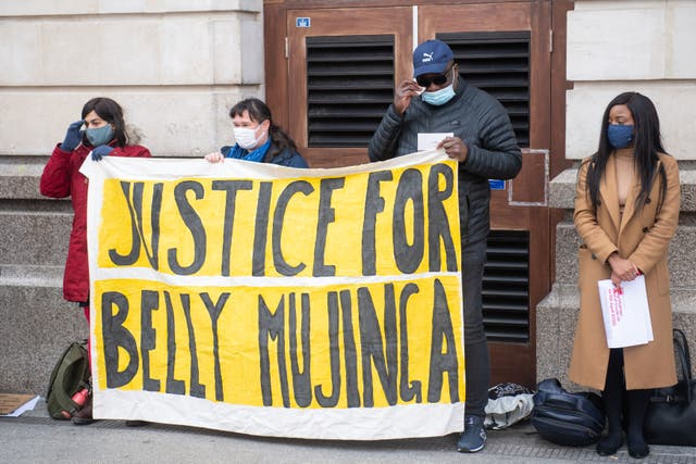 Lusamba Katalay (third from left), the husband of Belly Mujinga joins activists at a vigil at Victoria station in London to mark the first anniversary of the death of railway worker Belly Mujinga who died with Covid-19 following reports she had been coughed on by a customer at London's Victoria station
