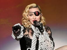 Madonna 'sits on a throne and gets fit guys to do her bidding', says Alan Carr