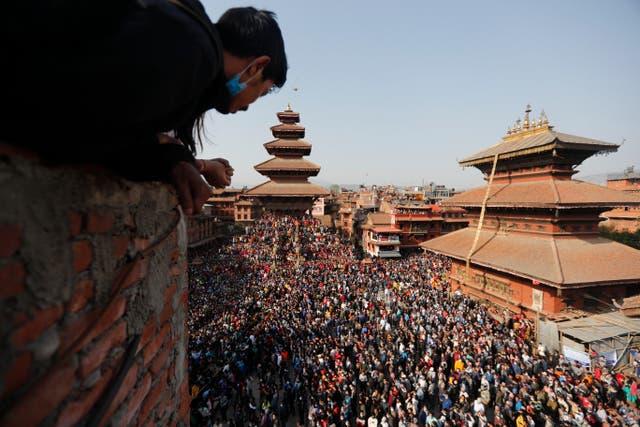 People watch devotees pulling a chariot in Biska Jatra Festival in Bhaktapur, Nepal