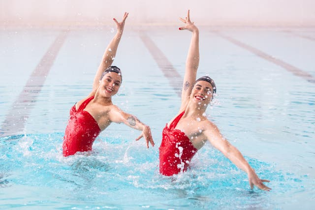 Rebecca Richardson (left) and Genevieve Florence, members of the Aquabatix synchronised swimming team, during a practice session in the swimming pool at Clissold Leisure Centre in north London, which has reopened to the public. Many facilities have reopened in the latest easing of lockdown include pubs and restaurants who can serve outside, non-essential shops, indoor gyms and swimming pools, nail salons and hairdressers, outdoor amusements and zoos