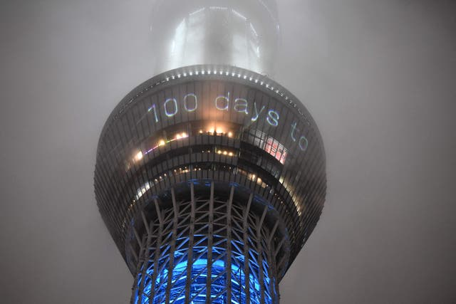 This picture shows the 100 days countdown till the start of the Tokyo 2020 Olympic Games displayed on the illuminated Tokyo Skytree in Tokyo on April 14, 2021