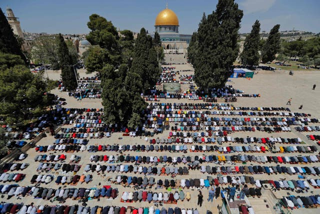 Palestinians take part in the first Friday prayers of the Muslim fasting month of Ramadan, at the Al-Aqsa Mosque compound, Islam's third holiest site, in Jerusalem's Old City