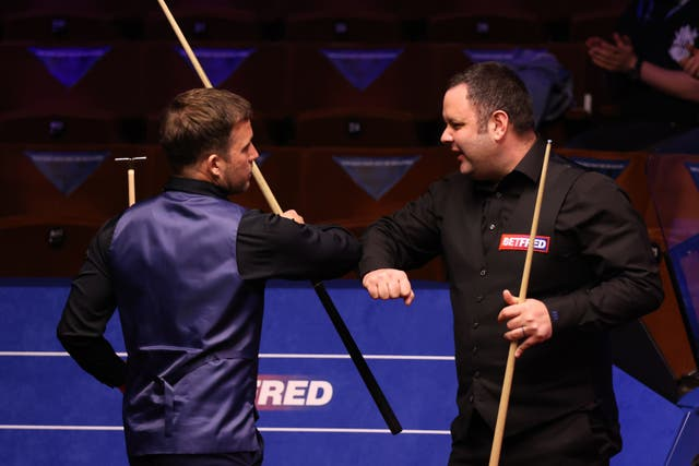 Stephen Maguire (right) of Scotland interacts with Jamie Jones of Wales during day 2 of the Betfred World Snooker Championships 2021 at The Crucible, Sheffield