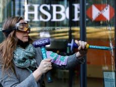 Extinction Rebellion activists smash windows at HSBC headquarters in Canary Wharf