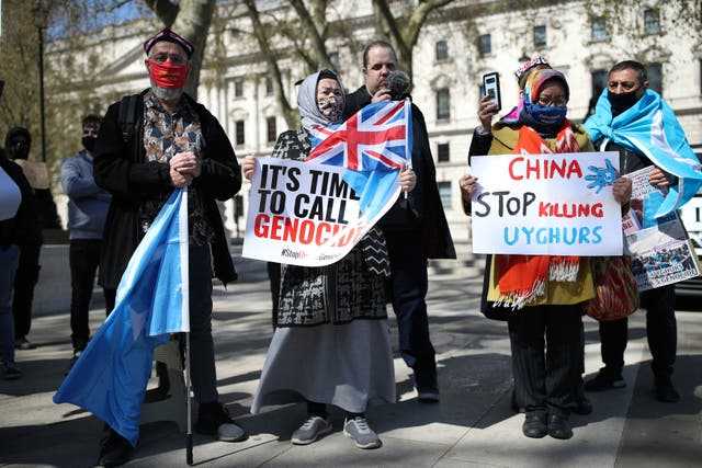 Uyghurs during a demonstration in Parliament Square, London, which is being held ahead of a House of Commons debate, bought by backbench MP Nus Ghani, on whether Uyghurs in China's Xinjiang province are suffering crimes against humanity and genocide