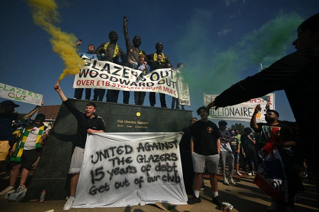 Supporters protest against Manchester United's owners, outside English Premier League club Manchester United's Old Trafford stadium in Manchester