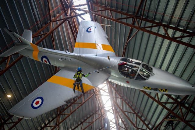 Specialist operators at the Royal Air Force Museum Cosford, near Telford, Shropshire, clean the Hawker Hunter aircraft displayed within the museum's National Cold War Exhibition, during annual high-level aircraft cleaning and maintenance