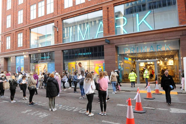 Shoppers queue outside Primark in Belfast as shops reopen and hospitality is able to open outdoors in Northern Ireland where lockdown restrictions have begun to gradually ease
