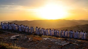 Samaritan worshippers arrive to take part in a Passover ceremony on top of Mount Gerizim, near the northern West Bank city of Nablus