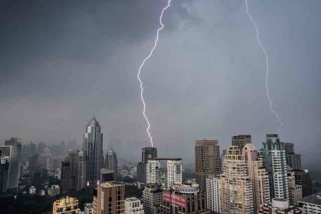 Lightning bolts strike buildings during a thunderstorm in Bangkok