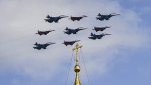 Russian MiG-29 jet fighters of the Strizhi (Swifts) and Su-30SM jet fighters of the Russkiye Vityazi (Russian Knights) aerobatic teams fly in formation over the Cathedral Square of the Kremlin in Moscow during a flypast rehearsal for the WWII Victory Parade