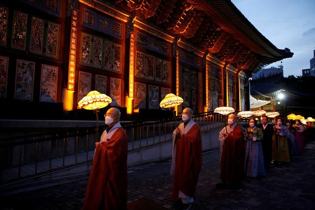 Buddhist monks and believers attend a lantern parade in celebration of the upcoming birthday of Buddha at a temple in Seoul, South Korea