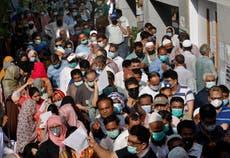 The Latest: Pakistanis shop ahead of weeklong lockdown