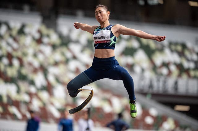 Maya Nakanishi competes in the women's long jump - T64 category during a para-athletics test event for the 2020 Olympics at the National Stadium in Tokyo