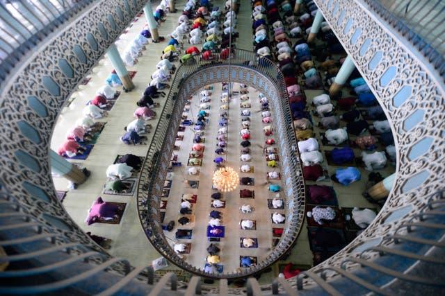 Muslims offer Eid al-Fitr prayers inside the Baitul Mukarram Mosque in Dhaka, Bangladesh