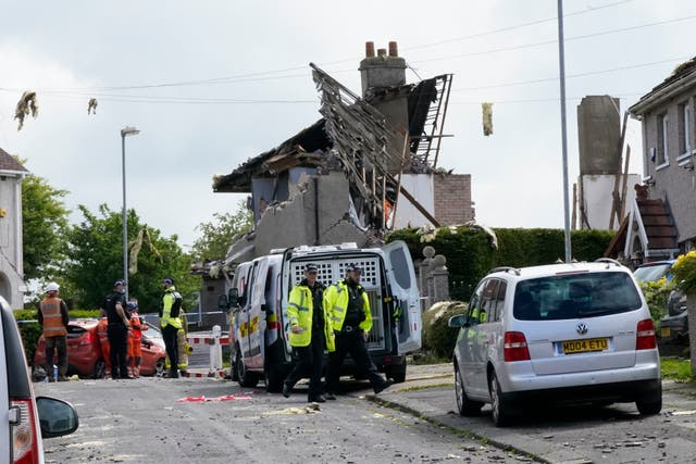 Emergency workers at the scene of a suspected gas explosion, in which a young child was killed and two people were seriously injured, on Mallowdale Ave Heysham which caused 2 houses to collapse and badly damaged another