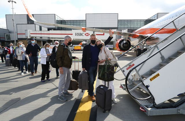 Passengers prepare to board an easyJet flight to Faro, Portugal, at Gatwick Airport after the ban on international leisure travel for people in England was lifted following the further easing of lockdown restrictions in England