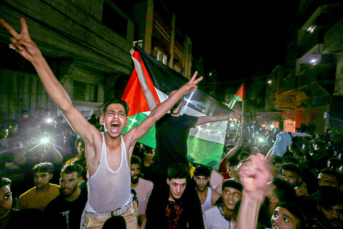 Palestinians break into celebration, sing and dance on streets after Israel-Gaza ceasefire