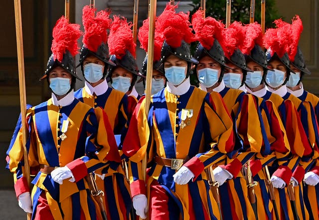 Swiss Guards take their position prior to the arrival of the European Commission President at San Damaso courtyard in The Vatican for a private audience with the Pope