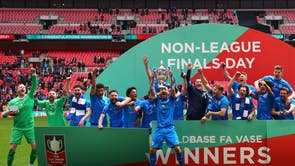 Gary Kenny lifts the Buildbase FA Vase Trophy after Warrington Rylands won the FA Vase Final against Binfield at Wembley Stadium