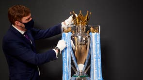The Premier League trophy with the Manchester City club colour ribbons on, at Etihad Stadium, prior to the last Premier League match of the season. City will finally pick up the trophy after they won the league on 11 Mai