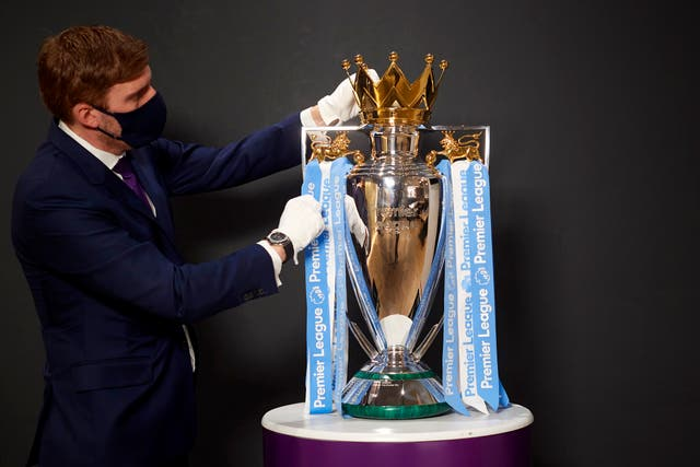 The Premier League trophy with the Manchester City club colour ribbons on, at Etihad Stadium, prior to the last Premier League match of the season. City will finally pick up the trophy after they won the league on 11 May