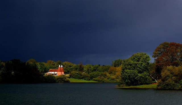 Dark rain clouds above an oast house at Bewl Water reservoir near Lamberhurst in Kent during one of the rainiest Mays on record, with the UK seeing 131 per cent of the usual month's rainfall already