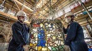 York Glaziers Trust employees Kieran Muir (left) and Emily Price (right) remove a stained glass window panel at the start of a new five year, £5m project to conserve York Minster's South East Transept and its medieval St Cuthbert Window
