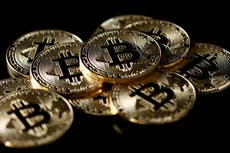 White House reviews 'gaps' in cryptocurrency rules as bitcoin swings wildly