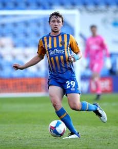 Matthew Pennington signs permanent Shrewsbury deal