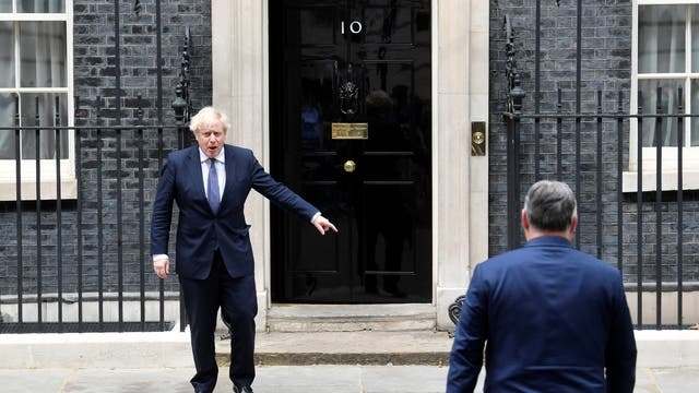 Britain's Prime Minister Boris Johnson gestures as he meets Hungary's Prime Minister Viktor Orban at Downing Street in London