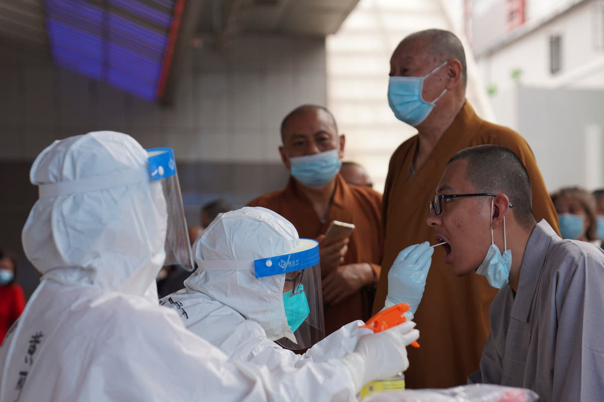 China re-imposes travel curbs on province after virus cases