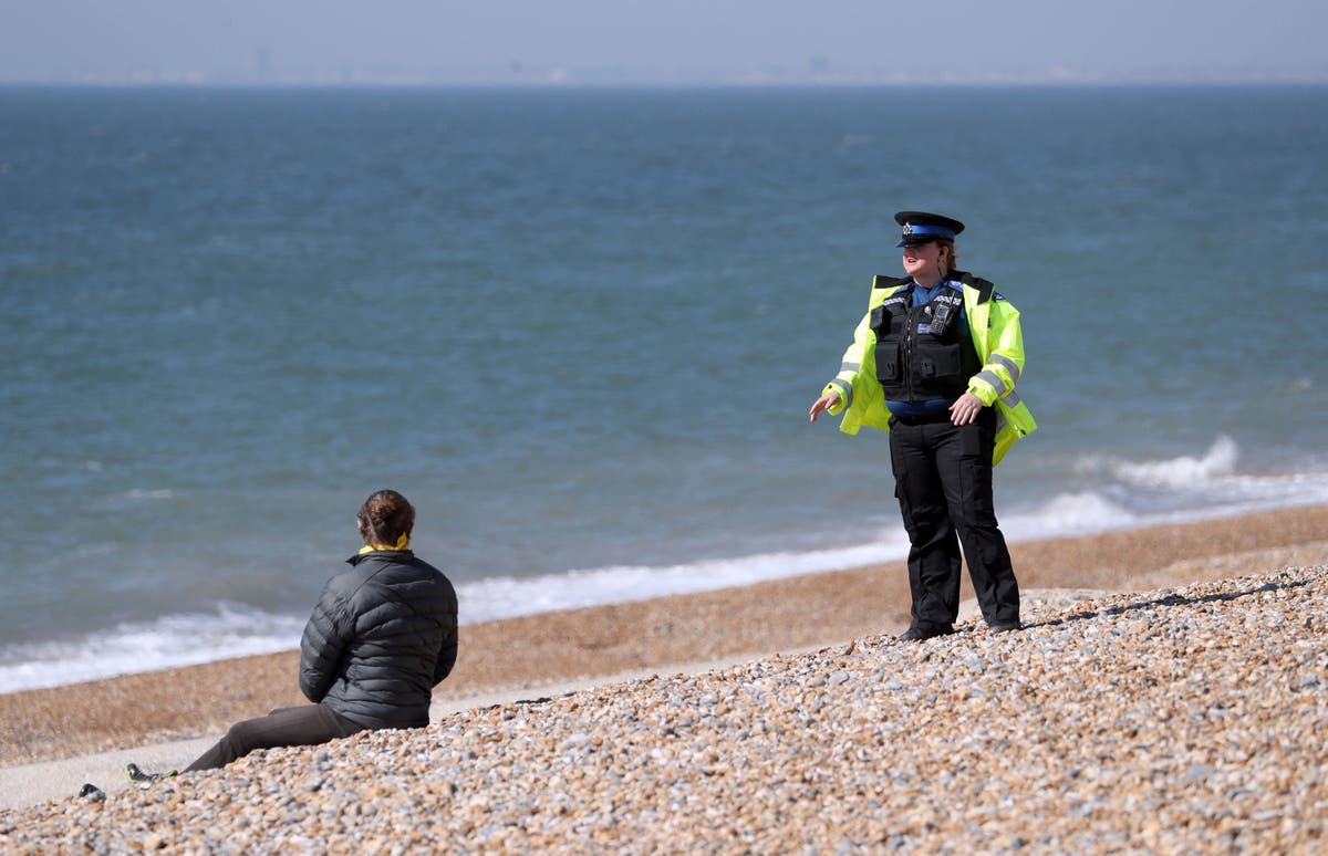 Three men in hospital after 'arranged fight' with sword and axe on Merseyside beach