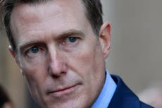 Australia minister drops defamation law suit over rape claim