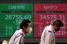 Asian shares mixed after lackluster day on Wall Street