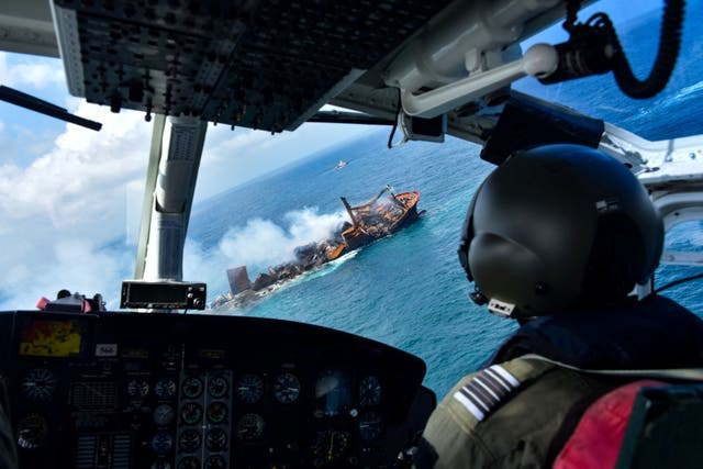 Smoke rises from a fire onboard the MV X-Press Pearl vessel as it sinks while being towed into deep sea off the Colombo Harbour, in Sri Lanka June 2, 2021
