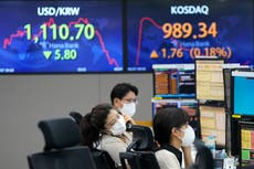 Asian shares trading mixed as optimism wears off on US rally