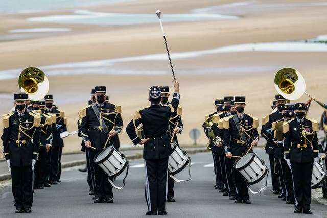 A military brass band plays during the international ceremony on the 77th anniversary of D-Day, at Omaha Beach in Vierville-sur-Mer, northwestern France