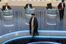 Outgoing Iran president, a debate target, defends his record