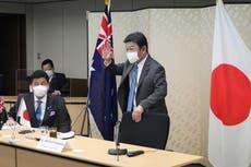 Japan, Australia share China concerns, raise defense ties
