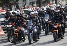 Bolsonaro fined as he flouts mask rule before motorcyclists