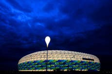 Several injured as Greenpeace protestor parachutes into Germany-France match