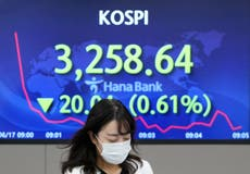 Asian stocks mixed after Wall St falls on Fed rate hike hint